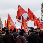 Russian Communist supporters walk along the Red square to lay flowers at Lenin's mausoleum in Moscow on November 5, 2017, to celebrate the forthcoming 100th anniversary of The Bolshevik Revolution. Russia is set to hold low-key events to mark a century since the 1917 Bolshevik Revolution on November 7, with authorities uncertain how to assess the uprising that led to 70 years of Communist rule. / AFP PHOTO / Mladen ANTONOV