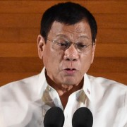 """Philippine President Rodrigo Duterte delivers his State of the Nation Address at Congress in Manila on July 25, 2016.  President Duterte vowed July 25 to show """"no mercy"""" in his bloody war on crime, warning criminals that priests and human rights advocates cannot protect them from being killed. / AFP / TED ALJIBE        (Photo credit should read TED ALJIBE/AFP/Getty Images)"""