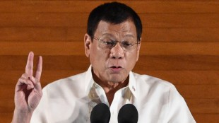 "Philippine President Rodrigo Duterte delivers his State of the Nation Address at Congress in Manila on July 25, 2016.  President Duterte vowed July 25 to show ""no mercy"" in his bloody war on crime, warning criminals that priests and human rights advocates cannot protect them from being killed. / AFP / TED ALJIBE        (Photo credit should read TED ALJIBE/AFP/Getty Images)"