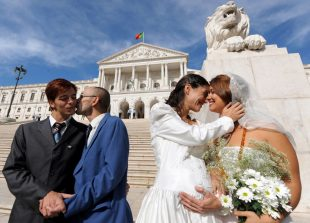 "Gay rights activists ""Jose"" (L) and ""manuel"" (2ndL) and ""Ana"" (2ndR) and ""Maria"" (R) stage a wedding ceremony in front of the Portuguese parliament in downtown Lisbon on October 10, 2008. Left-wing parties Bloco de Esquerda and Os Verdes failled today to pass a bill proposing to legalize gay marriage.     AFP PHOTO / FRANCISCO LEONG"